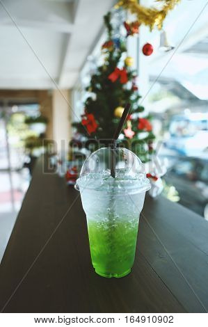 green soda on the table in coffee shop