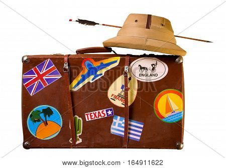 Old battered suitcase seasoned traveler with stickers from various countries he visited tropical helmet and broken through arrow. Isolated on White
