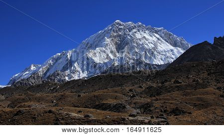 High mountain of the Himalayan range. South face of mount Nuptse Everest National Park Nepal.