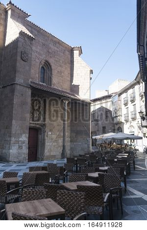 SALAMANCA, SPAIN - JULY 24, 2016: Salamanca (Castilla y Leon Spain): historic buildings with tables and chairs of a restaurant on the street