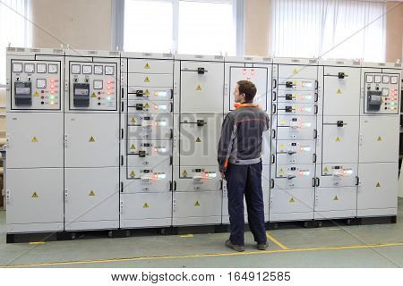 St. Petersburg Russia - October 4 2016: Engineer make Services electric transformer station or maintenance switchboard.