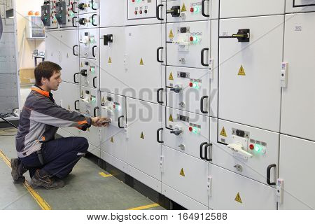 St. Petersburg Russia - October 4 2016: Electrical Engineer make Services Testing and Maintenance Low voltage switchgear.