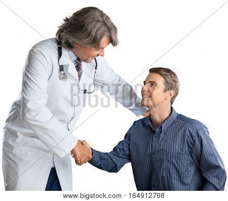 Portrait of a Mature Doctor Shaking Hands with Young Patient