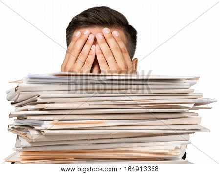Closeup of a Employee Covering his Eyes Behind a Stack of Folders