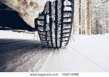 Detail of the tire on winter road.