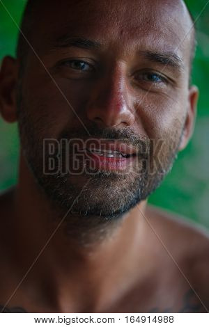 Portrait of a handsome man with a bald head