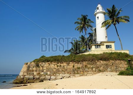 Colonial fine condition building development of the fort Galle on Sri Lanka. The photograph is presenting Galle Lighthouse on walls of the fort Sri Lanka
