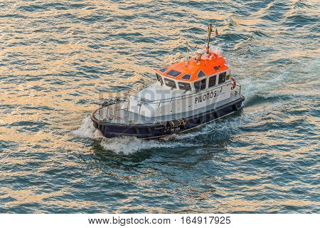 Funchal Madeira Portugal - December 10 2016: Pilot boat expected of going ship to enter the port of Funchal on Madeira Island Portugal.