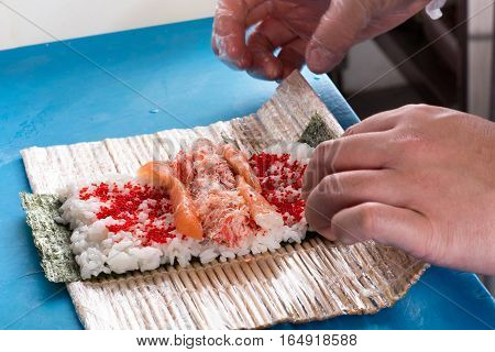 Preparing Sushi Rolls