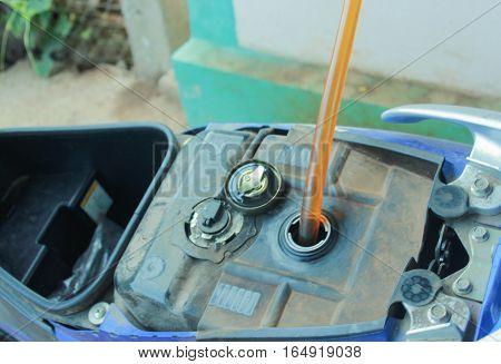 refill oil my motorcye by rubber tube