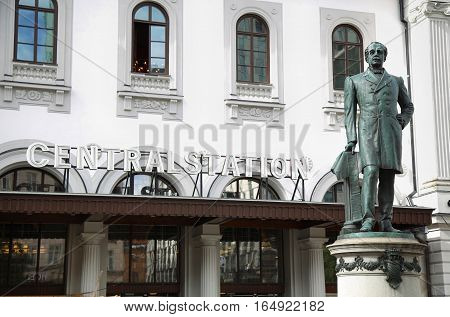 STOCKHOLM SWEDEN - AUGUST 19 2016: Statue of Nils Ericson in front of Stockholm Central Station and Stockholm Central Train Station in Stockholm Sweden on August 19 2016.