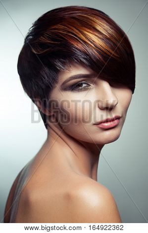 Fashion portrait of a beautiful girl with colored dyed hair, professional short hair coloring. studio shot.