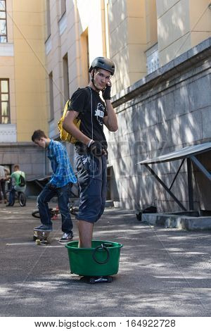 KAZAKHSTAN ALMATY - AUGUST 28, 2016: Urban extreme competition, where the city athletes compete in the disciplines: skateboard, roller skates, BMX. Bmx stunt performed at the top of a mini ramp on a skatepark.Skateboarding Practice Freestyle Extreme Sport