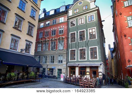 STOCKHOLM SWEDEN - AUGUST 19 2016: Cafes and restaurants at the Stortorget square(Gamla Stan).Stortorget is one of the most important squares in the Old Town in Stockholm Sweden on August 19 2016.