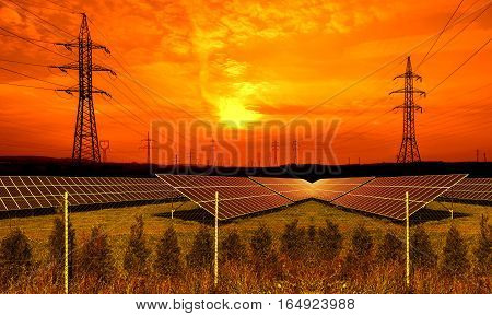 Solar energy panels with electricity pylon at sunset