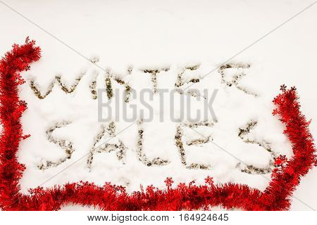 the written winter sales sculpted in the snow / the writing   winter sales