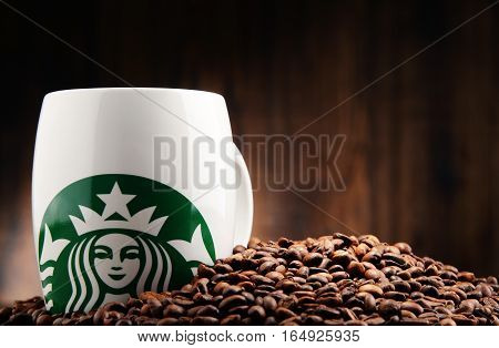 POZNAN POLAND - DEC 15 2016: Starbucks coffee company and coffeehouse chain founded in Seattle Wa. USA in 1971; now the largest business of this kind in the world operates 23450 locations
