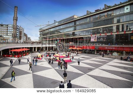 STOCKHOLM SWEDEN - AUGUST 19 2016: Pedestrian walk on Sergels Torg with the glass obelisk Kristallvertikalaccent It is central public square in the city in Stockholm Sweden on August 19 2016.