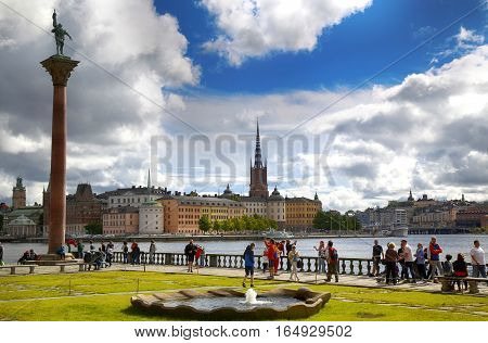 STOCKHOLM SWEDEN - AUGUST 19 2016: Tourists walk and visit Stockholm City Hall ( Stadshuset ) and View of Gamla Stan in Stockholm Sweden on August 19 2016.
