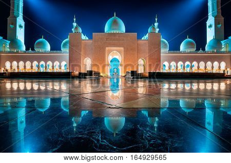 DUBAI UAE - MARCH 19 2014: Night view at Sheikh Zayed Grand Mosque Abu Dhabi United Arab Emirates
