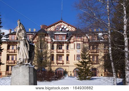 SLOVAKIA STARY SMOKOVEC - JANUARY 06 2015: View of the Grand Hotel in popular resort Stary Smokovec (High Tatras mountains) with half-timbered elements. The hotel was established in 1904.