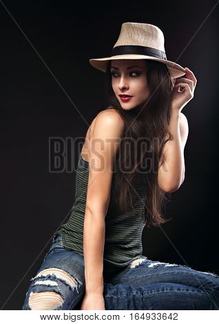 Beautiful Sexy Female Model With Holding The Hand Cowboy Summer Hat And Posing In Fashion Top And Ri