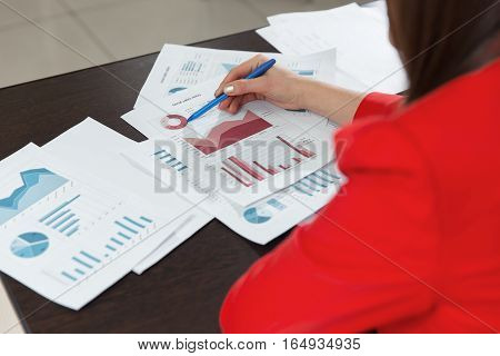 Business People Discussing The Charts And Graphs Showing The Results Of Their Successful Teamwork.