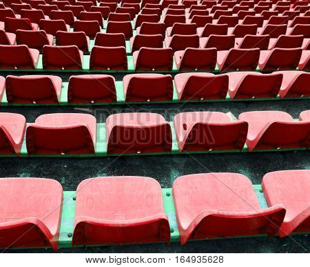 Red Empty Small Chairs On The Stadium