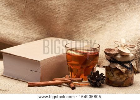 Glass Of Apple Juice, Nuts And Book