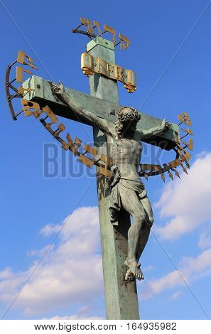 Old Crucifix With The Words Over To The Charles Bridge