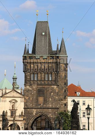 Tower With Battlements Of The Charles Bridge In Prague