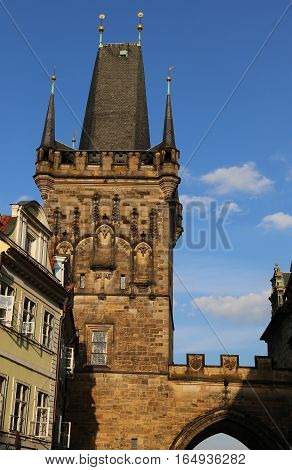 Tower With Battlements Of The Charles Bridge In Prague Old Town