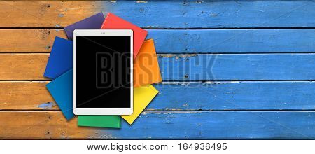tablet on pile of multicolored book in the form of a flower, on a background of old boards mockup, front view, 3d illustration