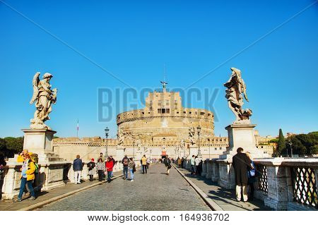 ROME - NOVEMBER 10: The Mausoleum of Hadrian (Castel and Ponte Sant'Angelo) with people on November 10 2016 in Rome Italy.