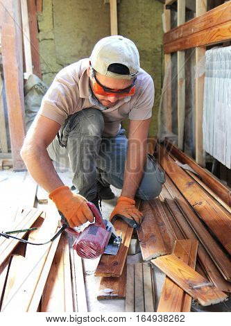 Man Building A House And Workimg With Wood