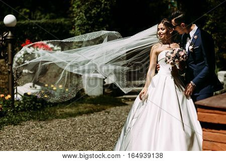 Bride In The Long Veil In The Windy Day