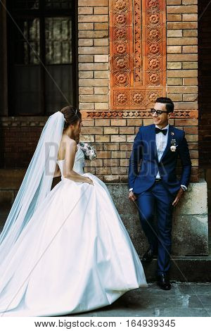 Bride walks to her handsome groom on the street