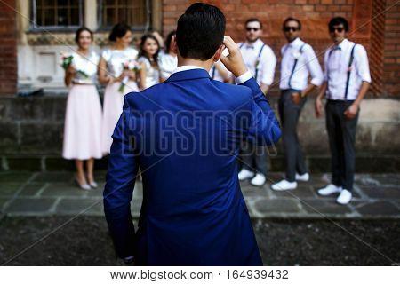 Groom Is Watching On The Groomsmen And Bridesmaids
