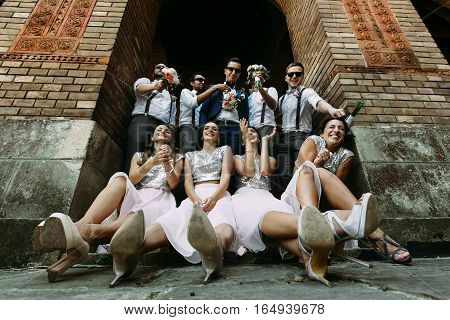 Bridesmaids in the glamorous dresses and the groomsmen