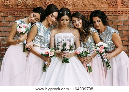 Cute Bridesmaids In The Stylish Dresses And A Bride