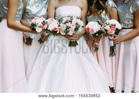 Amazing dresses of the bridesmaids and a bride