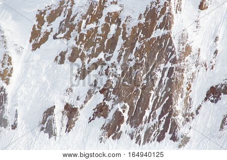 Rocks covered with snow outdoor. Snow avalanche