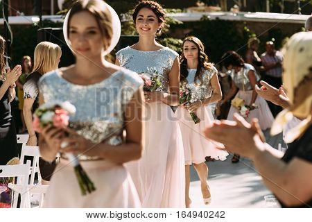 Glamorous Bridesmaids Are Walking On The Wedding Ceremony