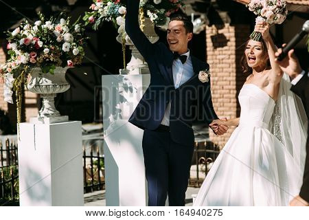 Cheerful Just Married Couple On The Wedding Ceremony