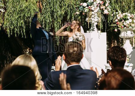 Couple Is Drinking Champagne On The Wedding Ceremony