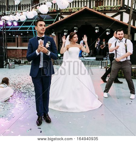 Funny dance moves of the bride and a groom