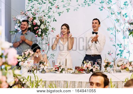 Happy emotions of the married couple in the restaurant