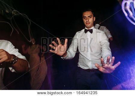 Funny groom on the dance floor on the wedding