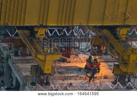 delhi, India - 8th Jan 2017: Equipment and crane for the construction of the Delhi metro in Noida. The massive crane lifts prefabricated blocks into place