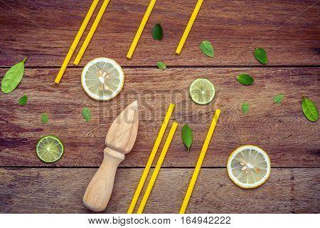 Fresh Lemon And Wooden Juicer For Summer Juice And Cocktail. Fresh Lemon Sliced ,lime Sliced ,yellow